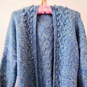 结构特殊的云纹女士棒针豆豆开衫毛衣